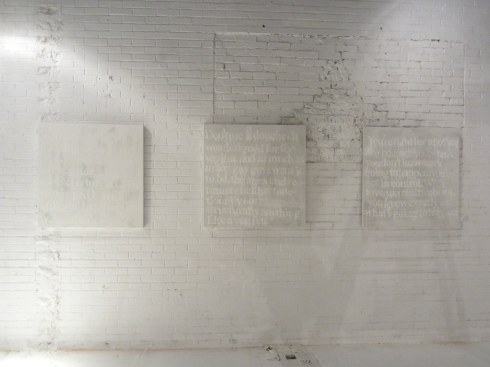 David Hardraker's shadow falls across my paintings as he installs the show the night before the opening.